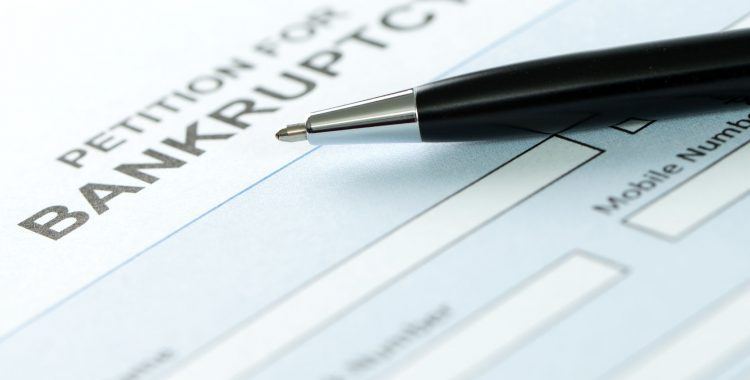 Close up of petition for bankruptcy form and pen, Business Bankruptcy Chicago IL, Top Bankruptcy Lawyers In Chicago Il